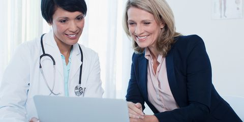 Female patient and doctor looking at computer screen
