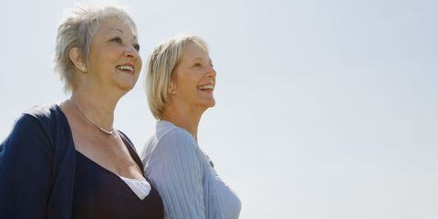 Two mature women smiling
