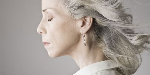 Mature woman side-on with eyes closed