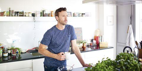 A man gazing across his kitchen