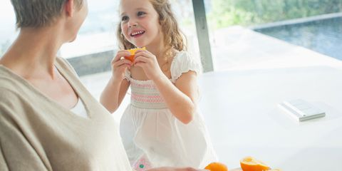 Child with orange shows mother