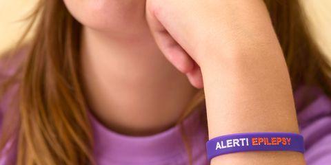 teenage girl wearing epilepsy alert bracelet