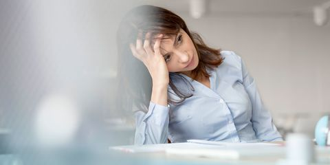 Depressed woman holding her head