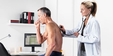 Man coughing, doctor with stephoscope