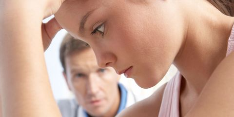A teenager looking worried