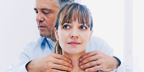 Doctor checking woman's glands/thyroid