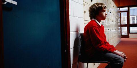 Child sat alone at school