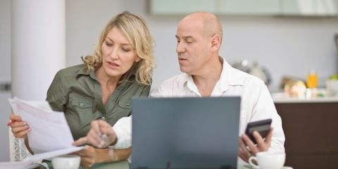 Couple looking at computer and calculator