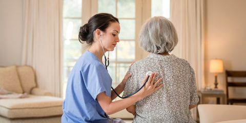 Elderly woman being examined by doctor
