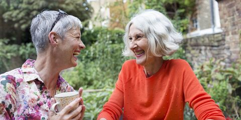 Two elderly women laughing