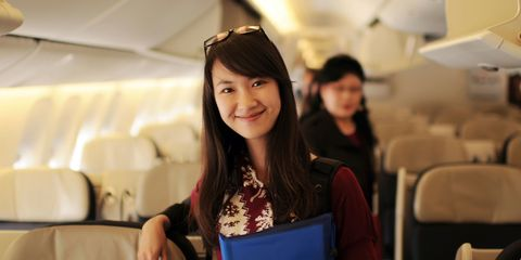 woman standing and smiling on plane