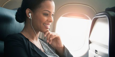 woman on plane travelling to holiday destination