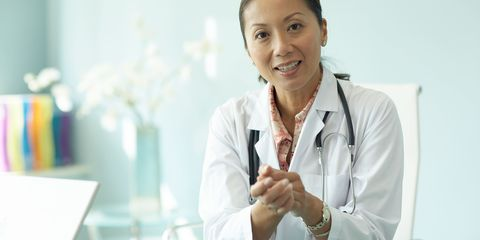 doctor in GP surgery