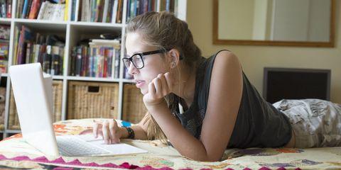 Teenage girl on laptop