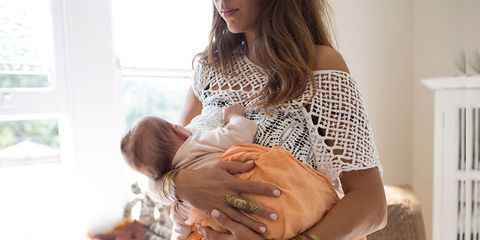 Young woman breastfeeding baby