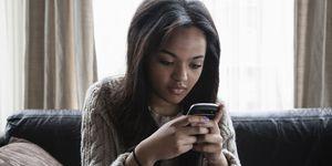Teenager on mobile phone