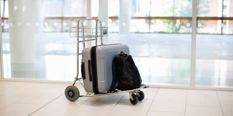 luggage on an airport trolley