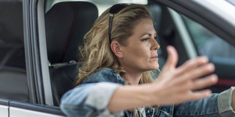 Angry and frustrated woman driving