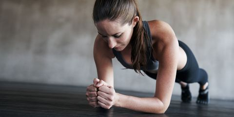 Woman planking exercising in the gym