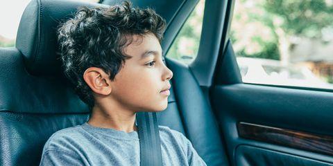 Little boy sitting in car