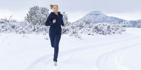 Woman running/jogging in the snow/winter