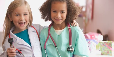 Smile, Eye, Uniform, Iris, Stethoscope, Tooth, Jheri curl, Brown hair, Ringlet, Nurse,