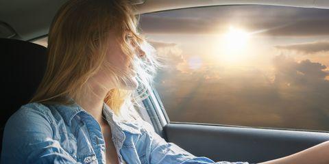 Denim, Light, Vehicle door, Sunlight, Comfort, Long hair, Blond, Brown hair, Street fashion, Automotive window part,