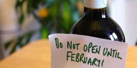 Glass bottle, Bottle, Drink, Alcohol, Wine bottle, Alcoholic beverage, Handwriting, Label, Distilled beverage, Wine,