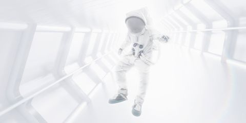 Astronaut floating in space tunnel