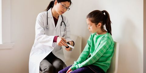 Young girl with doctor