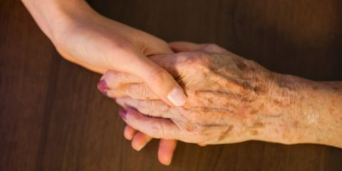 Holding hands older and younger woman
