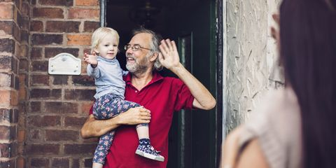 Toddler with grandpa waving goodbye