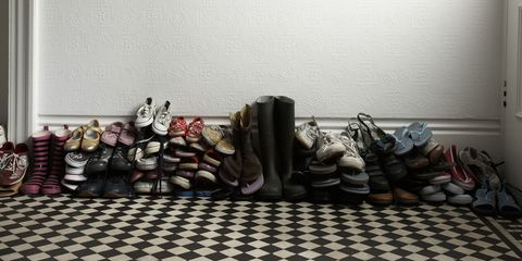 Piled up shoes near front door