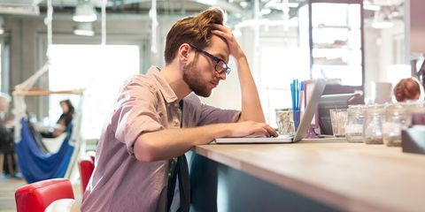 Stressed out man working on laptop