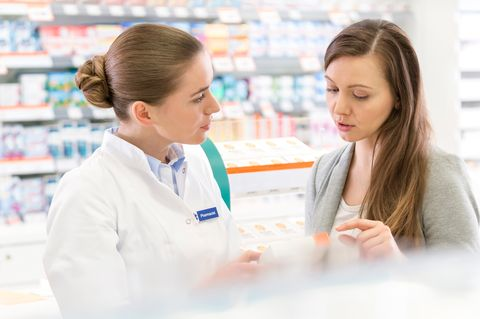 Pharmacist and patient in pharmacy