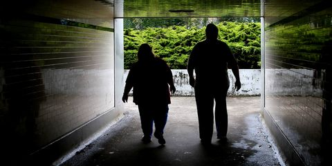 Overweight couple walking through tunnel