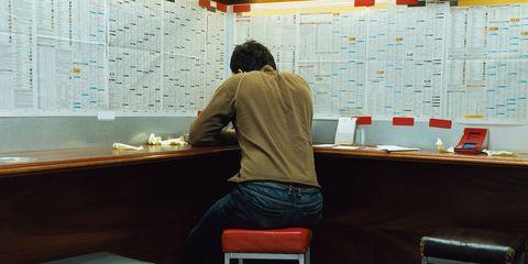 Man in betting shop