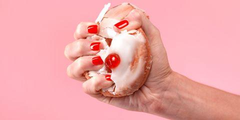 Hand crushing donut