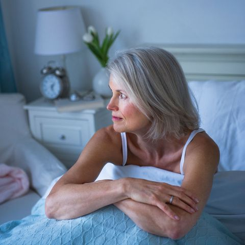 Woman in bed can't sleep with insomnia