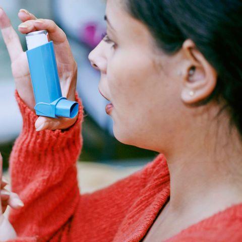 Woman using an inhaler