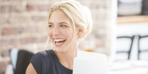 Woman with blonde hair laughing