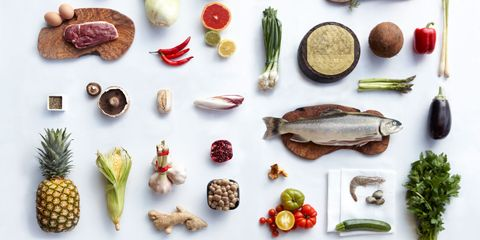 A selection of healthy ingredients for cooking against a white table cloth.