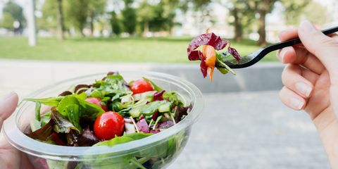Eating salad in park