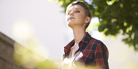Woman breathing in fresh air outside