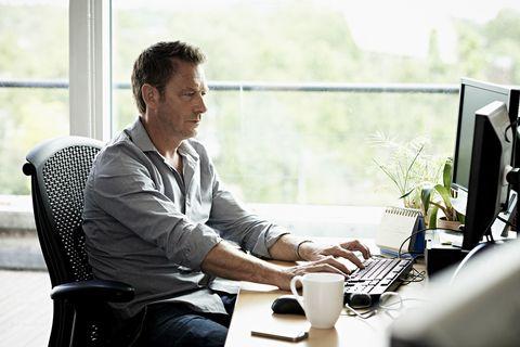 Man working sitting at desk