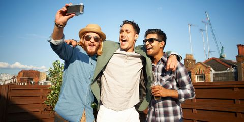 Male friends taking a photo