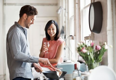 Couple at home cooking