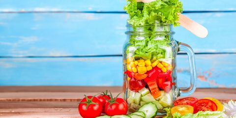 Colourful vegetable salad in a Mason jar