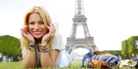 Woman smiling on grass in front of eiffel tower Paris France