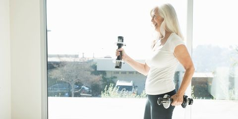 Older woman exercising with weights